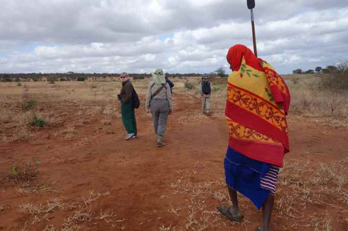 Walking on the Maasai Steppe, I got to know Johana, another of our Maasai guides (he's holding the spear); I already knew another Joanna (she's looking back at me).
