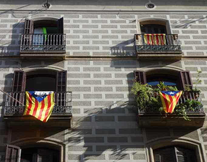 They hang the Catalonia flag from their apartments, too.