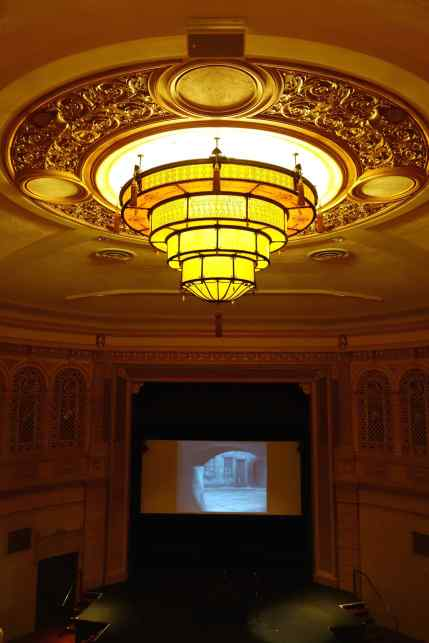 I love the colors and the tone of the light in this chandelier above the theater.
