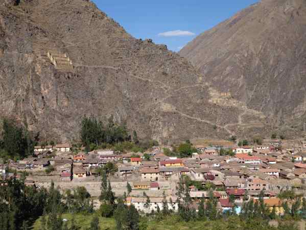 Look up there on the mountain above the town. Do you see those buildings? That's where the Inca stored food supplies.